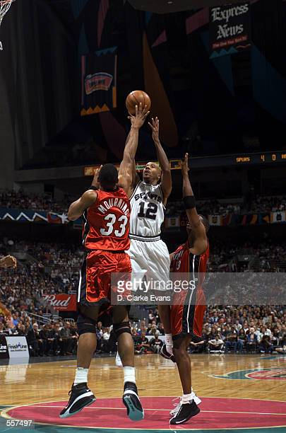 Guard Bruce Bowen of the San Antonio Spurs shoots over center Alonzo Mourning of the Miami Heat during the NBA game at the Alamodome in San Antonio...
