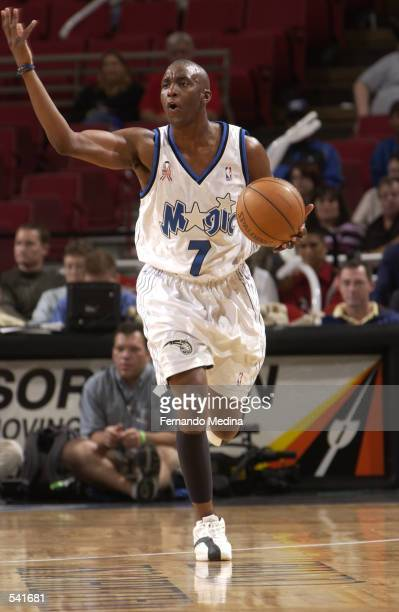 Guard Dee Brown of the Orlando Magic dribbles the ball during the NBA game against the Charlotte Hornets at TD Waterhouse Centre in Orlando Florida...