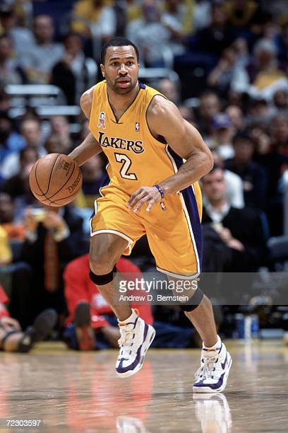 Guard Derek Fisher of the Los Angeles Lakers dribbles the ball during the NBA game against the Houston Rockets at the Staples Center in Los Angeles...