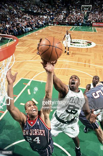 Guard Eric Williams of the Boston Celtics and forward Richard Jefferson of the New Jersey Nets attempt to rebound the ball during the NBA game at the...