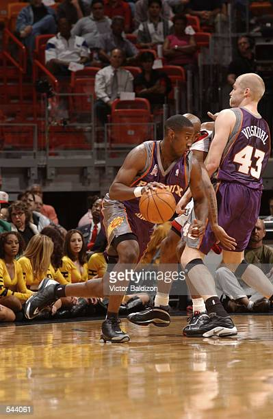 Guard Joe Johnson of the Phoenix Suns dribbles the ball during the NBA game against the Miami Heat at American Airlines Arena in Miami Florida The...