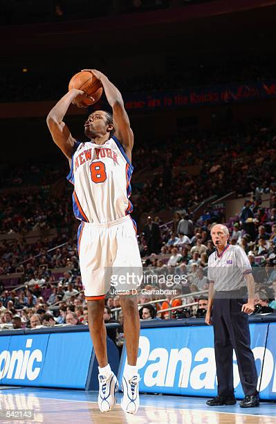 Guard Latrell Sprewell of the New York Knicks shoots the ball during the NBA game against the Denver Nuggets at Madison Square Garden in New York New...