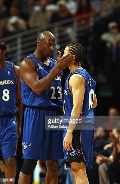 Guard Michael Jordan of the Washington Wizards talks to point guard Tyronn Lue during the NBA game against the Denver Nuggets at the Pepsi Center in...
