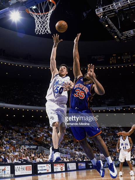 Guard Mike Miller of the Orlando Magic shoots the ball as center Kurt Thomas of the New York Knicks attempts to block during the NBA game at the TD...