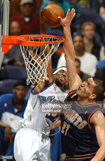 Guard Richard Hamilton of the Washington Wizards dunks over center Mengke Bateer of the Denver Nuggets during the NBA game at MCI Center in...