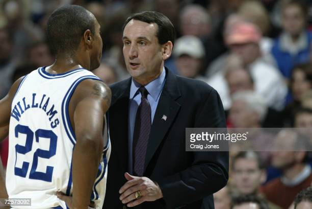 Head coach Mike Krzyzewsk od Duke instructs Jason Williams during the ACC Tournament championship game against North Carolina State at the Charlotte...