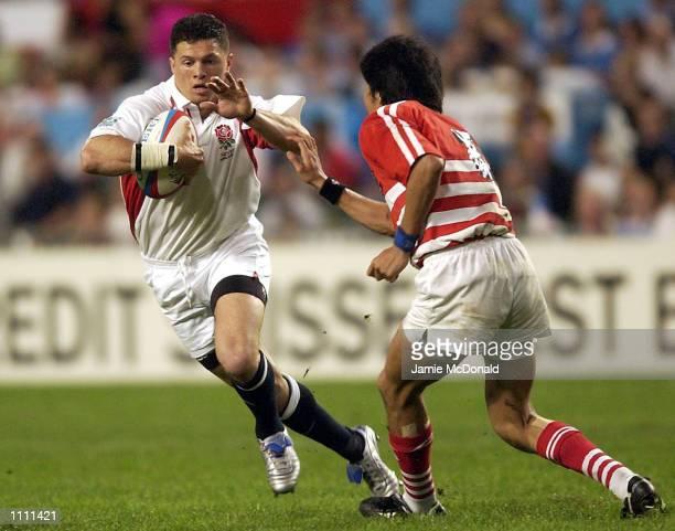 Henry Paul of England skips the tackle of Wataru Ikeda of Japan during the Credit Suisse First Boston Hong Kong Sevens at the Hong Kong Stadium Hong...