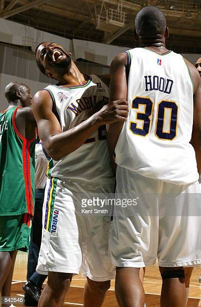 Isaac Fontaine and Derek Hood of the Mobile Revelers celebrate after the NBDL playoff game against the North Charleston Lowgators at the North...