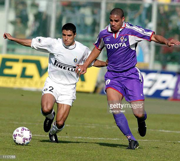 Ivan Cordoba of Inter Milan and Adriano of Fiorentina in action during the Serie A match between Fiorentina and Inter Milan played at the Artemio...