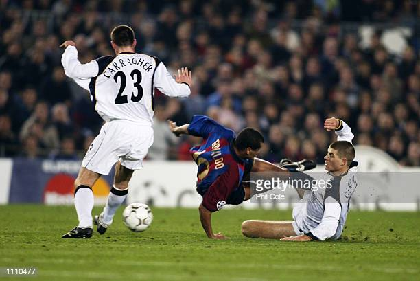 Jamie Carragher and Steven Gerrard of Liverpool stop Rivaldo of Barcelona creating any opportunities to score during the UEFA Champions League Group...