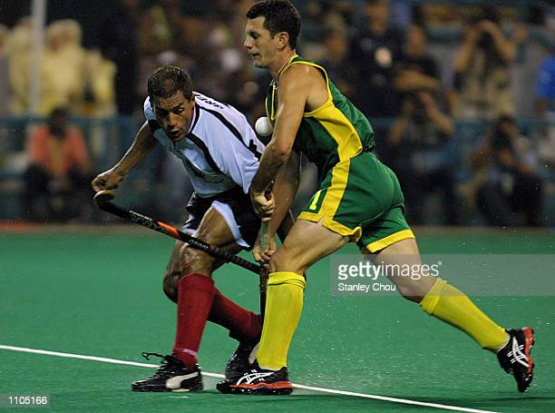 Jamie Dwyer of Australia battles with Michael Green of Germany during the World Cup Hockey final between Australia and Germany held at the Bukit...