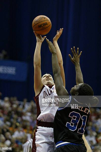 Jamie Talbert of Oklahoma shoots while defended by Wynter Whitley of Duke during the NCAA Women's Final Four Game at the Alamo Dome in San...