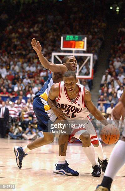 Jason Gardner of Arizona dribbles around the defense of BJ Ward of UCSB during the first round of the NCAA Baketball Tournament at The Pit in...