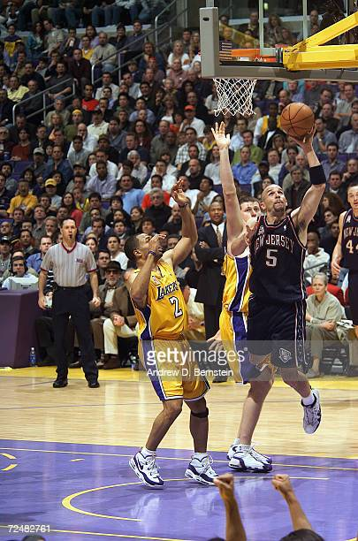 Jason Kidd of the New Jersey Nets goes to the basket past Derek Fisher of the Los Angeles Laker at Staples Center in Los Angeles California The...