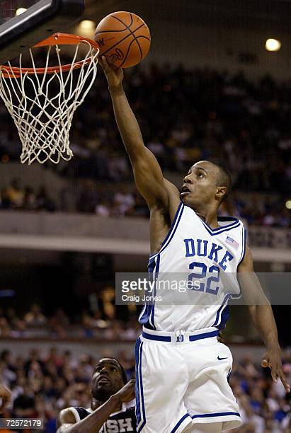 Jason Williams of Duke drives to the basket during their game with Notre Dame during the NCAA 2nd round basketball game at the BiLo Center in...