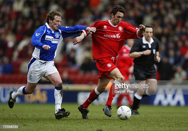 Jonathan Greening of Middlesbrough takes the ball past Scot Gemmill of Everton during the AXA sponsored FA Cup quarterfinals match played at the...