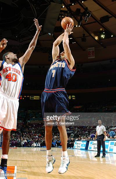 Juwan Howard of the Denver Nuggets shoots over Kurt Thomas of the New York Knicks at Madison Square Garden in New York New York DIGITAL IMAGE Note to...