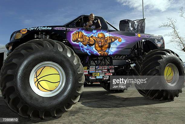 Karl Malone of the Utah Jazz leans out the window of the Monster Truck that he sponsors at Sam Boyd Stadium in Las Vegas Nevada He flew to Las Vegas...