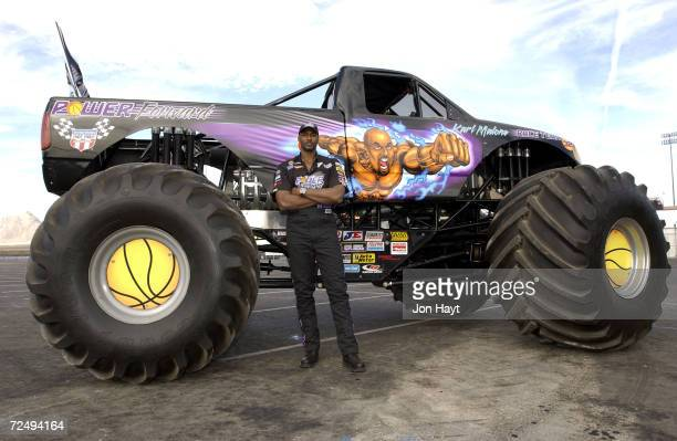Karl Malone of the Utah Jazz poses in front of the Monster Truck that he sponsors at Sam Boyd Stadium in Las Vegas Nevada He flew to Las Vegas on...