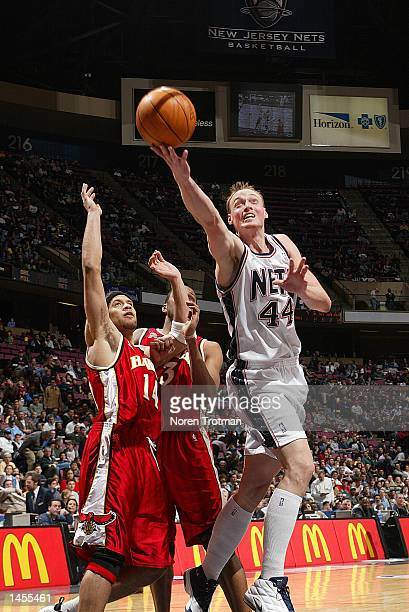 Keith Van Horn of the New Jersey Nets gets the layup past Ira Newbie and Shareef AbdurRahim of the Atlanta Hawks during the NBA game at Continental...
