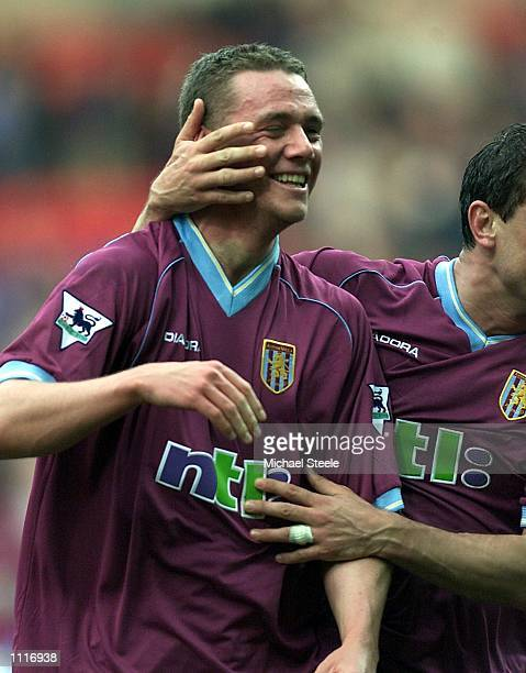 Kevin Nolan of Bolton Wanderers celebrates his two goals and victory after swapping shirts in the FA Barclaycard Premiership match at the Reebok...