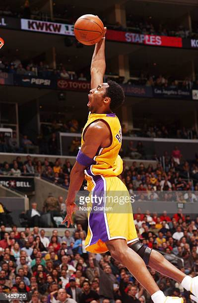 Kobe Bryant of the Los Angeles Lakers flies to the hoop against the Indiana Pacers during the first half of action at Staples Center in Los Angeles...