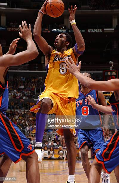 Kobe Bryant of the Los Angeles Lakers goes through the New York Knicks defense at Staples Center in Los Angeles California DIGITAL IMAGE NOTE TO USER...