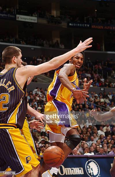 Kobe Bryant of the Los Angeles Lakers passes against the Indiana Pacers defense during the first half of action at Staples Center in Los Angeles,...