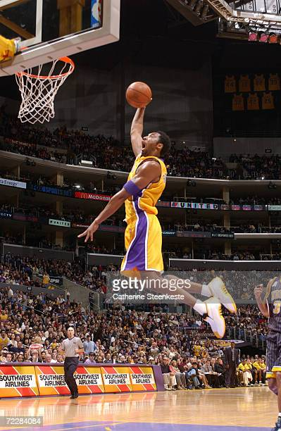 Kobe Bryant of the Los Angeles Lakers with a fast break to the hoop against the Indiana Pacers during the first half of action at Staples Center in...