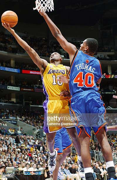 Lindsey Hunter of the Los Angeles Lakers goes to the basket against Kurt Thomas of the New York Knicks during their game at Staples Center inLos...