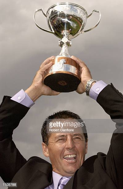 Lindsey Smith trainer of winning horse Old Comrade riden by Paul Harvey celebrates during the Australian Cup Horse Racing Carnival held at the...