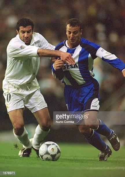 Luis Figo of Real Madrid battles with Fran of Deportivo La Coruna during the Spanish Copa del Rey Final between Real Madrid and Deportivo La Coruna...