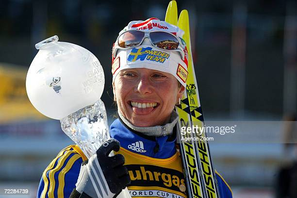 Magdalena Forsberg of Sweden has a light moment after being named overall winner for the year of the Women's World Cup Biathlon at the Biathlon World...