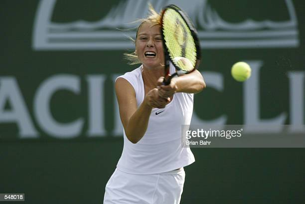 Maria Sharapova defeats Brie Rippner 57 62 62 during her match at the Pacific Life Open in Indian Wells California DIGITAL IMAGE Mandatory Credit...