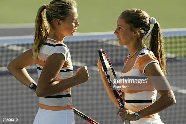 Maria Sharapova of Russia and Gisela Dulko of Argentina consult during their loss to Arantxa SanchezVicario of Spain and Daniela Hantuchova of...