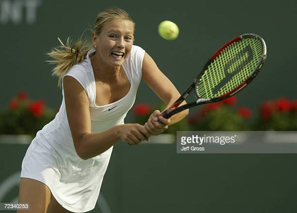 Maria Sharapova of Russia hits a backhand against Brie Rippner during the first round of the Pacific Life Open at the Indian Wells Tennis Garden in...