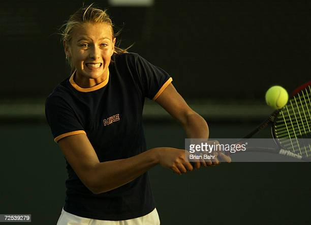 Maria Sharapova of Russia returns a volley during a training session before the Pacific Life Open on the practice courts of the Indian Wells Tennis...