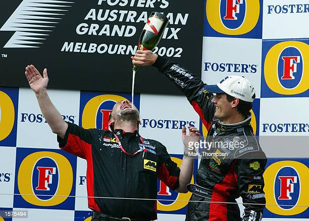 Mark Webber of Australia and Minardi celebrates with team boss Paul Stoddart after his 5th place finish in the 2002 Fosters Australian Grand Prix at...