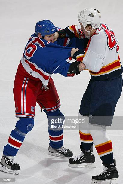Matthew Barnaby of the New York Rangers tries to avoid the punches of Brad Ference of the Florida Panthers during the game at National Car Rental...