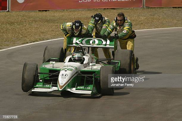 Members of the Simple Green Safety Team give Paul Tracy in the Team KOOL Green Honda Reynard a push start during practice for the Tecate Telmex Grand...