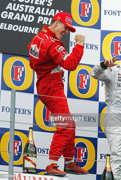 Michael Schumacher of Germany and Ferrari celebrates after his victory in the 2002 Fosters Australian Grand Prix at the Albert Park Circuit Melbourne...