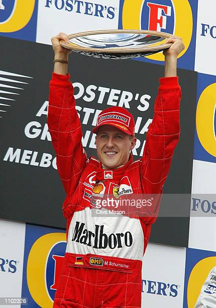 Michael Schumacher of Germany celebrates after his victory in the 2002 Fosters Australian Grand Prix at the Albert Park Circuit, Melbourne,...