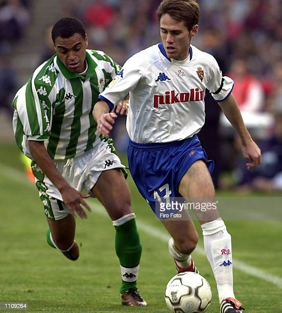 Miguel Corona of Real Zaragoza and Denilson of Real Betis in action during the Primera Liga match between Real Zaragoza and Real Betis played at the...