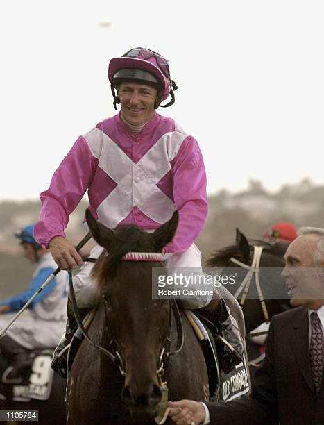 Paul Harvey jockey of winning horse Old Comrade is jubilant after his win during the Australian Cup Horse Racing Carnival held at the Flemington Race...