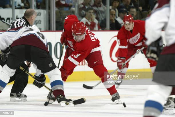Pavel Datsyuk of the Detroit Red Wings sets up for a face off against Stephane Yelle of the Colorado Avalanche during the game at the Pepsi Center in...