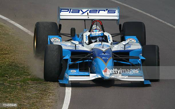 Player's Forsythe Racing driver Alex Tagliani drives his Ford Reynard partly on the grass during the first qualifying session of the Tecate Telmex...