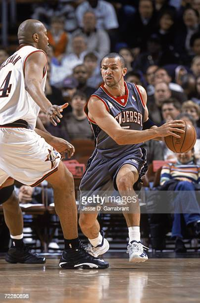 Point guard Jason Kidd of the New Jersey Nets passes around forward Derrick Coleman of the Philadelphia 76ers during the NBA game at the First Union...