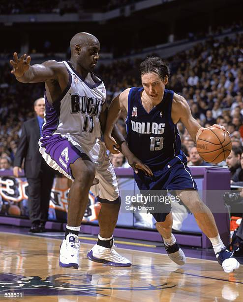 Point Guard Steve Nash of the Dallas Mavericks dribbledrives around the defense of Forward Anthony Mason of the Milwaukee Bucks during the NBA game...