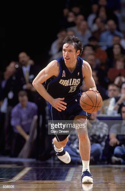 Point Guard Steve Nash of the Dallas Mavericks dribbles the ball down court during the NBA game against the Milwaukee Bucks at the Bradley Center in...