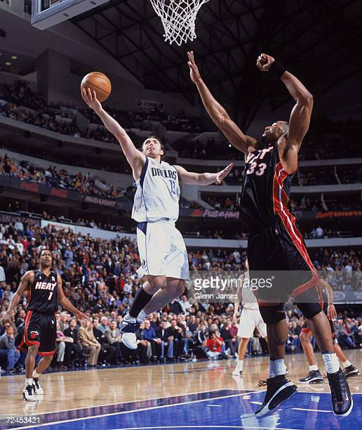 Point guard Steve Nash of the Dallas Mavericks shoots the ball over center Alonzo Mourning of the Miami Heat during the NBA game at the American...